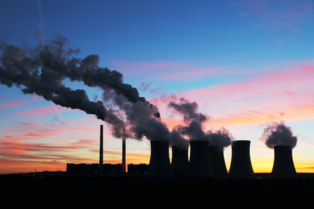 factory power generation: dramatic sunset over coal power plant