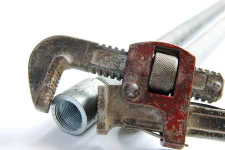 pipe wrench with water pipes on white background