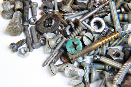A lot of screws and nuts on a white background Stock Photo