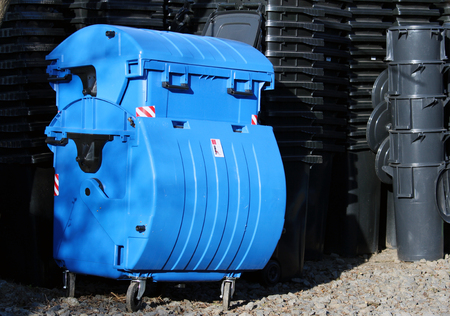 blue and black municipal waste dust bins