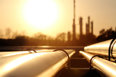 fuel storage: golden steel pipe network in crude oil refinery