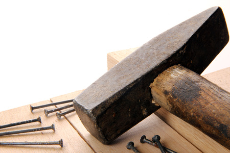 hammer and nails on wooden board in studio