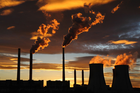 golden sunset over smoking power house plant factory Stock Photo - 73061017