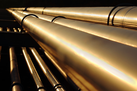 golden steel pipes in oil refinery during sunset Stock Photo