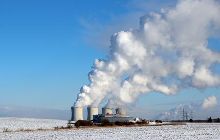 huge white smoke from factory in winter Stock Photo