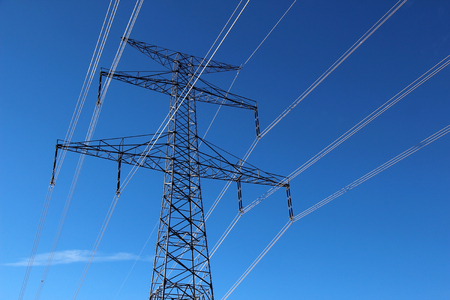 high voltage  steel pylon against blue sky