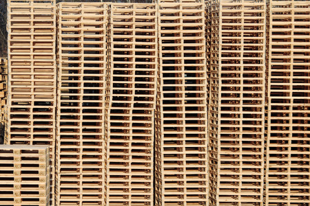 wooden pallets on stock in factory backyard