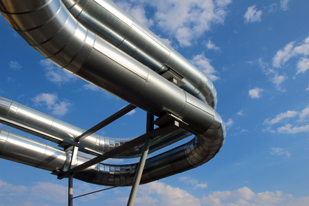 steel pipes under blue sky in industrial zone Stock Photo