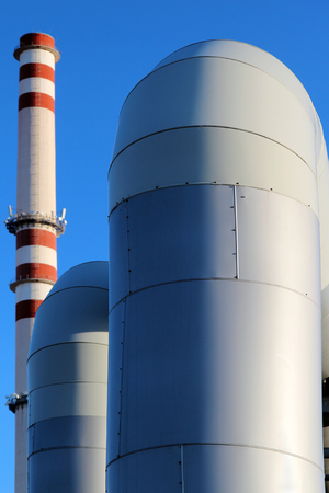huge pipe in steel factory under blue sky Stock Photo