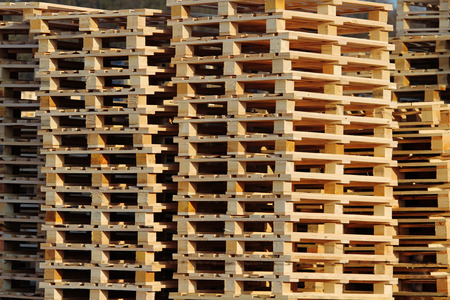 wooden euro pallets on warehouse backyard
