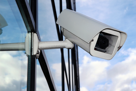 Digital CCTV camera on the glass facade