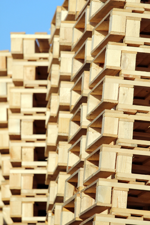 stacked wooden pallet under blue sky