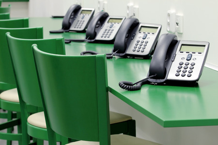 detail of green call centrum with ip phones