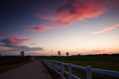 View of farm by sunset