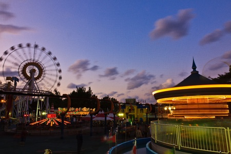 View of amusement park by dusk