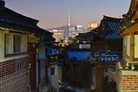 Contrast between old and modern cityscape at night