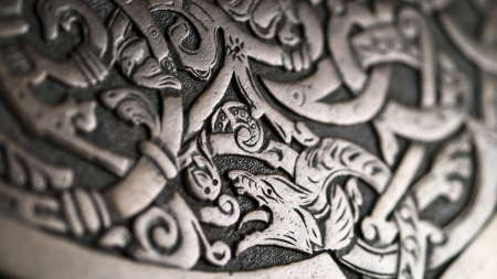 norse: Viking wood carving depicting a wolf or a dragon, low depth of field
