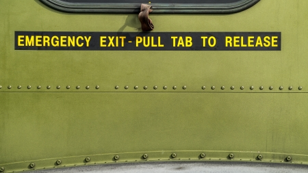 Emergency exit, pull tab to release