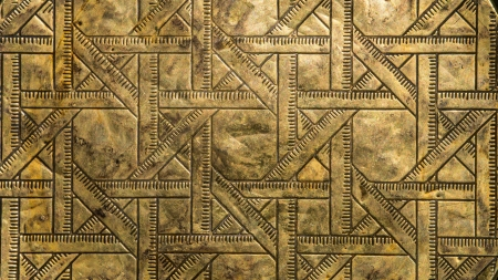 patina: Abstract  ruler like  pattern in brass with patina Stock Photo