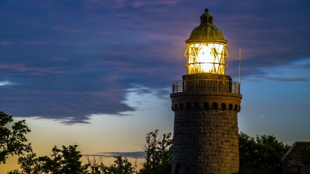 midsummer: Granite lighthouse by during a Scandinavian midsummer midnight on the island of Bornholm from the side Stock Photo