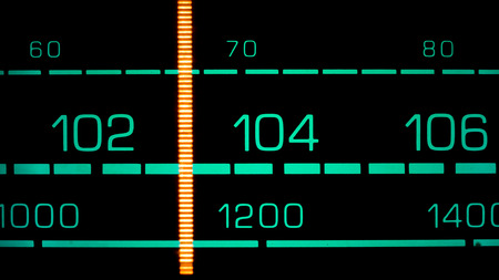 fm: Tuning into 103 MHz FM on an old 70s radio receiver Stock Photo