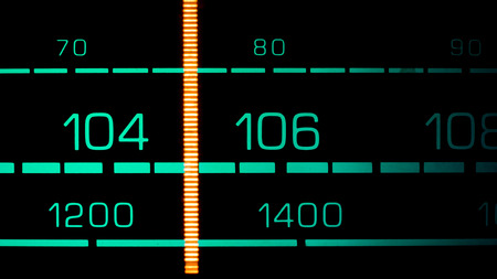 fm: Tuning into 105 MHz FM on an old 70s radio receiver Stock Photo