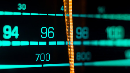 70s: Tuning into 96FM, 700KHz AM on an old 70s radio receiver seen from the side