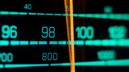 hi fi: Tuning into 98FM, 800Khz AM, on an old 70s radio receiver seen from the side