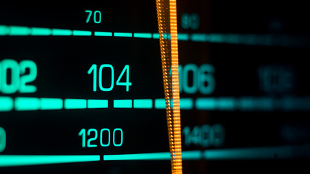 70's: Tuning into 104FM, 1200Khz AM, on an old 70s radio receiver seen from the side Stock Photo