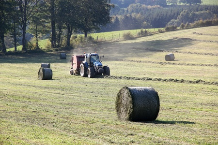 tractor collecting hay, Belgian Ardennes