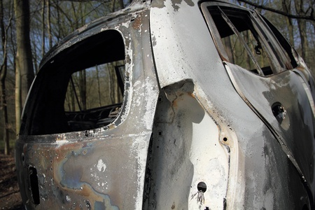 burnt car wreck in forest  1 Stock Photo - 13084091