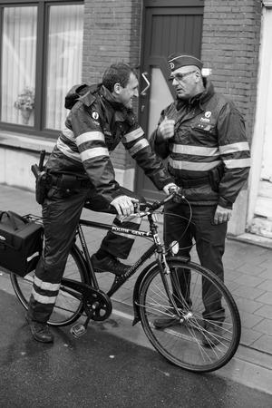 Police officers in the regen, Gentbrugge, Belgium
