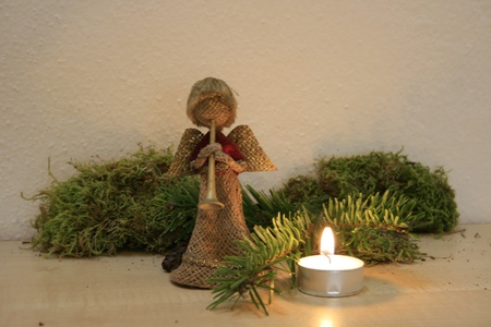 blessedness: christmas angle, candle, christmas ceiling, pine braches, moss Stock Photo