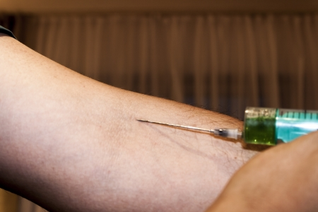 knave: Injection of a drug into the arm Stock Photo