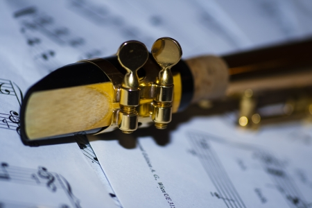 soprano: A soprano saxophone lying on sheet music