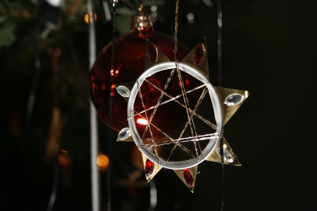 chrstmas: Homemade Christmas star with red glass beads