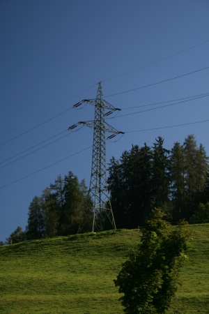 Electricity pylons on a hill with cable in Tyrol photo