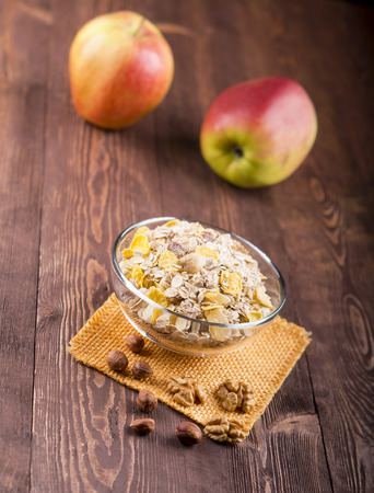 glycemic: bowl of muesli, apple, nuts, flakes, candied  for a nutritious breakfast with a low glycemic index ensuring plenty of energy for the day. Stock Photo