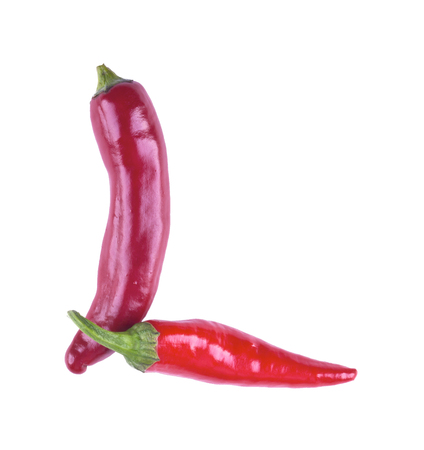 hot couple: Letter L with red chili pepper on a white background. The letter  L from the peppers isolated. Stock Photo