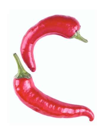 hot couple: Letter C with red chili pepper on a white background. The letter C from the peppers isolated. Stock Photo
