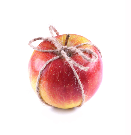 red ripe apple isolated corded Stock Photo