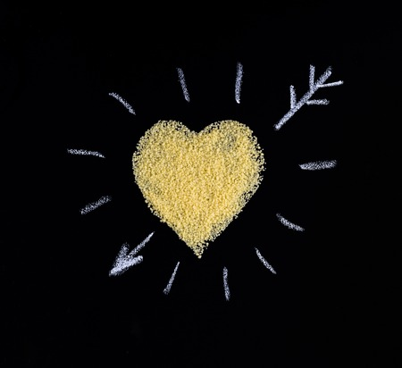 heartshaped: Heart made of couscous on a black background. I like couscous.