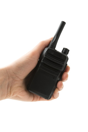 Portable radio transceiver in hand, isolated on white background photo
