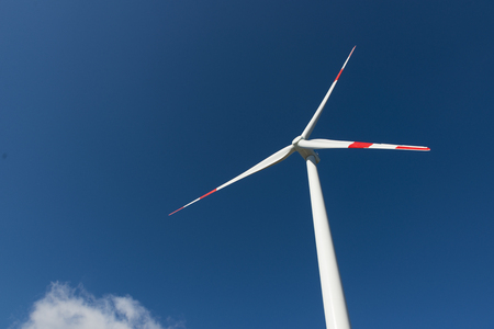 Wind turbines generate electricity with blue sky Stock Photo