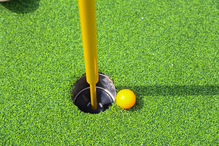 golf stick: golf ball on lip of cup Stock Photo