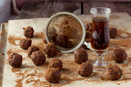 gauze: Small glass of brandy, gauze and homemade candies wooden table