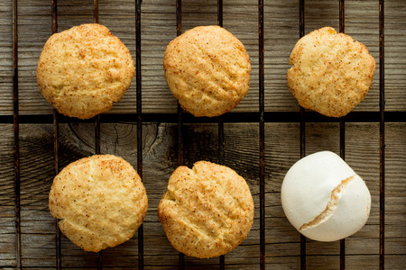 kiss biscuits: Shortbread cookies and merengue on wire rack wooden table top view Stock Photo