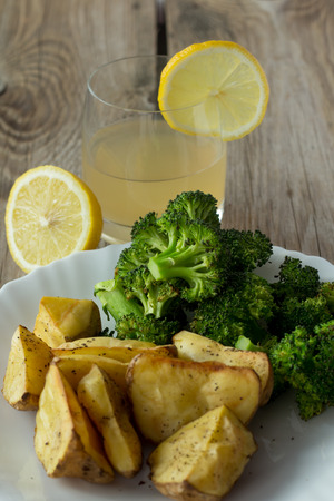 pineapple juice: Shot of grilled potatoes and broccoli and pineapple juice