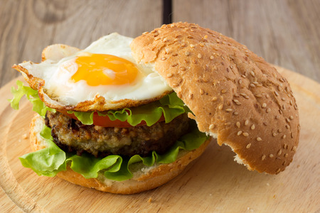 Shot of burger with fried egg photo