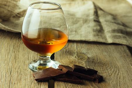cognac: Cognac glass and chocolate horizontal selective focus